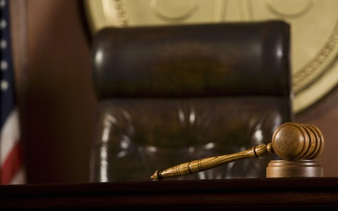 Gavel and empty chair